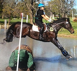 Jeri on horse Oliver jumping obstacle over water